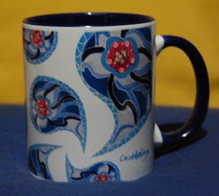Blue mug with the author's signature